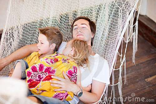 father-his-kids-relaxing-hammock-20037082